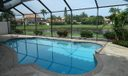 SCREENED IN GRAND POOL WITH LAKE VIEWS