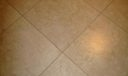 Neutral tile flooring throughout