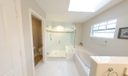 Master bathroom with frameless glass sho
