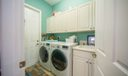 LAUNDRY ROOM WITH CABINETS AND SINK