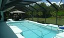 Screened  and solar heated pool