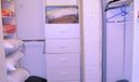 Huge walk in closet in guest bedroom wit