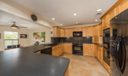 kitchen opens to family and living areas