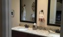 MB granite & rich wood cabinetry