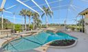 Pool and spa with screened patio