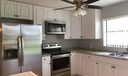 LR to Kitchen & Screened Patio