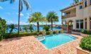 Pool/spa overlooking water