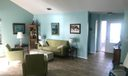 living room with bright front entry