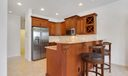 Stainless, granite, upgraded cabinetry