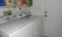 Utility Room W/ Washer & Dryer