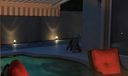 Custom lighting and pool awning