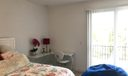 2nd bedroom w/balcony