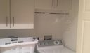 Laundry Area with Built-In Cabinetry