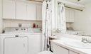 Half Bathroom/Laundry Area