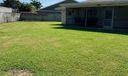 Back exterior and sideyard