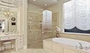 Jetted Tub and Frameless Shower