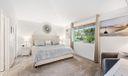 Cozy master bedroom with flat screen tv.