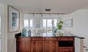 Kitchen opens to Living and Dining Rooms
