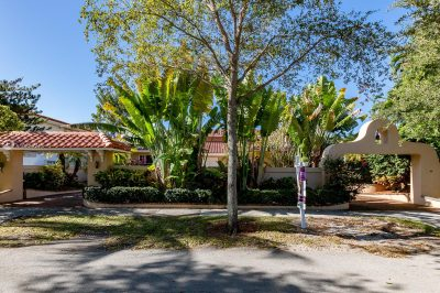 Located in Bay Heights, this property is fully gated with an electric gate at each end of the circular driveway.