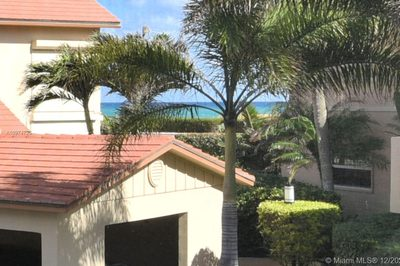 Areal photos of Beachcomber Community. Condo faces directly EAST