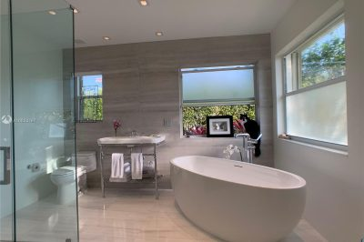 Stunning Spa master bathroom with Waterworks's stand alone tub and bath filler and faucets, marble floors and accent wall and shower walls and floor