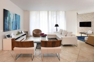 Beautiful and spacious living room with floor to ceiling windows and adjacent family room/second living room. Doors open to big balcony with garden views, Lots of natural light!
