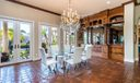 Breakfast Room open to Kitchen, overlooks the luscious backyard/waterway