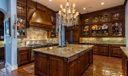 Kitchen - SS appliances, 2 dishwashers, ice maker, 3 sinks, 2 refrigerators/freezers, seating