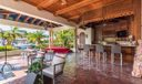 Outdoor Loggia featuring a cabana bathroom, and full summer kitchen, custom built stage for entertaining.