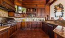Outdoor Kitchen & Bar-Gas Grill/Smoker/Griddle, TV, ice maker, and freezer, bar height seating