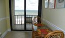Kitchen eating area and East balcony with direct ocean view