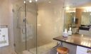 Master bathroom has large glass shower with built-in bench