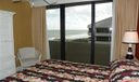 Guest bedroom with South balcony and direct ocean views