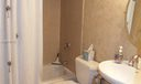Guest bathroom has tub/shower combination