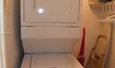 Washer/dryer in walk-in laundry room in unit.