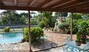Additional view of large covered pool patio area.  Tiered garden area