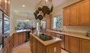 Kitchen. Chef s kitchen, includes warming tray, double wall ovens and subzero refridgerator