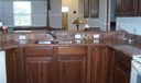 Kitchen. Overlooking family room. Cherry cabinets, Italian granite counters