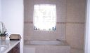 Master Bath/Spa. Spa tub with sculpted glass window and double walk in shower behind the window.