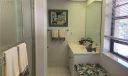 main bath with window seat (storage)