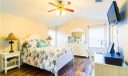 Spacious remodeled master suite complete with 2 walk in closets.