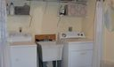 A very large laundry room provides great additional storage!