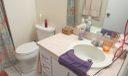 Three-piece master bathroom has a spacious shower