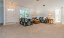 Entry Foyer with Tile opens to large great room with vaulted ceilings and freshly painted walls, double window and new carpet.