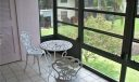Glass screened enclosed balcony with storage area