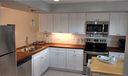 BRAND NEW shaker style kitchen cabinets, tile & glass backsplash, new flooring, new stainless appliances.