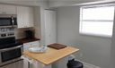 Another view of brand new kitchen with island