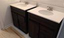 """BRAND NEW double master vanities with sliding """"barn"""" doors, new fixtures & bead board"""