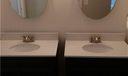 """Brand New his & Her vanities with """"barn doors"""", new fixtures, new mirrors & new lighting."""