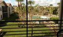 Private view of community pool from screened balcony